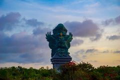 Picture of Garuda statue as Bali landmark with blue sky as a background. Balinese traditional symbol of hindu religion. Landscape picture of Garuda statue as royalty free stock photo