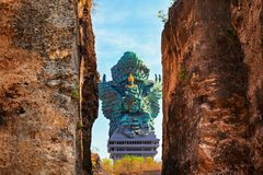 Landscape picture of old Garuda Wisnu Kencana GWK statue as Bali landmark with blue sky as a background. Balinese traditional royalty free stock photo