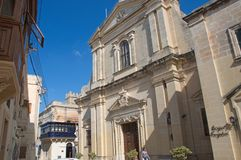 Malta, Rabat: Landscape of Medieval architecture. Landscape of picturesque, wooden and traditional balconies and Medieval church in Rabat, Malta Stock Photo