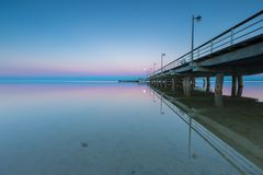 Landscape of pier in Jastarnia photographed before sunrise. Landscape of Gdanska bay with pier in Jastarnia photographed before sunrise.Landscape with pastel Stock Image