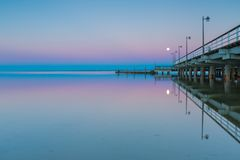 Landscape of pier in Jastarnia photographed before sunrise. Landscape of Gdanska bay with pier in Jastarnia photographed before sunrise.Landscape with pastel Royalty Free Stock Photography
