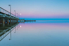 Landscape of pier in Jastarnia photographed before sunrise. Landscape of Gdanska bay with pier in Jastarnia photographed before sunrise.Landscape with pastel Royalty Free Stock Photo