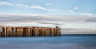 A landscape of a pier and the sea stock photo