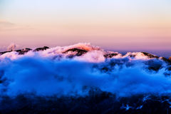Landscape with pink clouds over mountain Stock Photography