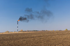 Landscape with pipe of burning oil-well gas stock photo