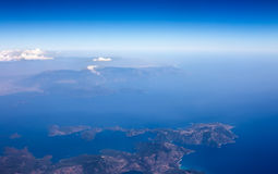 Landscape from the plane window, show the land, sea and clouds. a beautiful view of nature Royalty Free Stock Photos