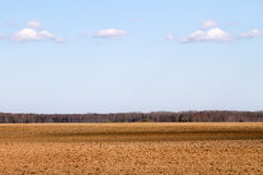 Landscape with plowed field. Royalty Free Stock Image