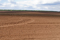 Landscape with plowed field. Photographed in Russia, in the countryside Royalty Free Stock Photo