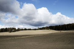Landscape with plowed field in spring. Finland Royalty Free Stock Photo