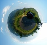 Landscape polar panorama. A landscape polar panorama of Alsace, France. Includes grassy hills, a man, and a car stock image