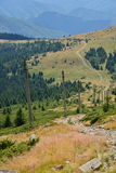 Landscape with poles and country road in the Apuseni mountains. Royalty Free Stock Photography