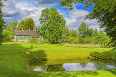 Landscape with a pond Stock Photos