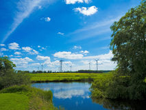 Landscape, pond and wind farm Royalty Free Stock Photo