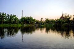 Landscape of ponds and backyard. In a rural village of Thailand have reflection water at twilight stock images