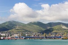 The landscape of the port, on the background of sea and mountain Stock Photos