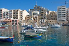 Malta, St. Julian`s: Landscape of the port with colorful traditional Maltase boats. Landscape of the port with colorful traditional Maltese boats in St. Julian`s Royalty Free Stock Photo