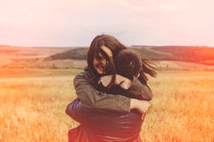 Landscape portrait of young beautiful stylish couple sensual and. Having fun outdoor. Film effect Stock Photos