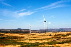 Wind turbines on hilly expanse create energy, Portugal Europe. Landscape from Portugal, Serra D`Aire. wind power plant clouds dark breeze draught nature royalty free stock image