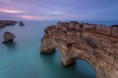 Landscape Portugal at Sunrise. Marinha Beach. Landscape of the South Coast of Portugal at Sunrise. Marinha Beach is a holiday destination for its beautiful Royalty Free Stock Photography