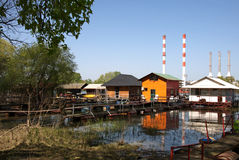 Landscape of rafts, cottages and thermo power station at the river Sava in Belgrade Royalty Free Stock Photo