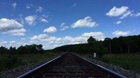 Landscape, railroad and blue sky with clouds timelapse. The Landscape, railroad and blue sky with clouds timelapse stock footage