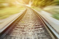 Landscape of railroad tracks with motion blur effect Royalty Free Stock Images