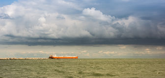 Landscape with rain clouds over the sea Stock Image