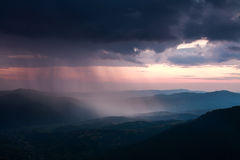 Landscape of rain clouds over the valley between mountains Royalty Free Stock Photo