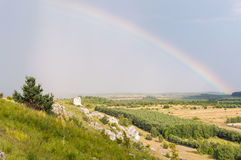 Landscape with rain and rainbow Stock Photo