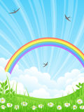 Landscape with a Rainbow. Beautiful summer landscape with rainbow Stock Photography