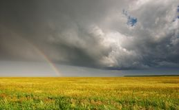 Landscape with rainbow. Landscape with storm clouds and rainbow Stock Photo