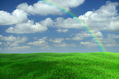 Landscape Rainbow. Landscape with a clouds, rainbow, sky and grass Stock Photos