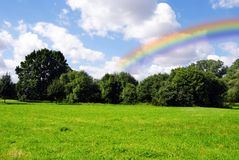 Landscape with rainbow stock photography