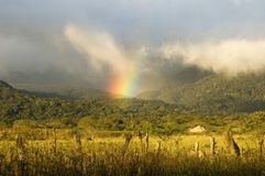Landscape with rainbow in Costa Rica. Royalty Free Stock Photos