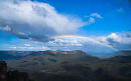 Landscape rainbow and green mountains. Royalty Free Stock Images