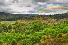 Landscape with rainbow after rain Royalty Free Stock Photo