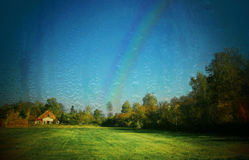 Landscape with rainbow. Landscape after rain with rainbow Stock Photo