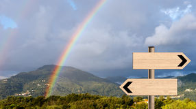 Landscape rainbow with signposts. Life direction metaphor. Beautiful double rainbow landscape. Walking, trekking etc or psychology, life direction metaphor Stock Photo
