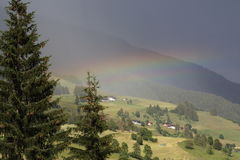 Landscape with rainbow.   Stock Images