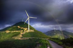 Rainbow and windmill in the mountains after rain royalty free stock photography
