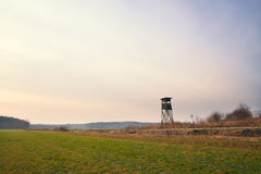 Landscape with raised hide in field Stock Photos