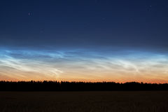 Landscape with rare noctilucent clouds Royalty Free Stock Photo