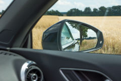 Landscape in the rear-view mirrors Stock Image