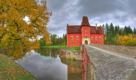 Landscape with Red /Cervena/ Lhota castle, Czech Republic. Beautiful autumn picture whith colored trees, lake, bridge and castle on the lake. Photography was royalty free stock photos