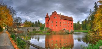 Landscape with Red /Cervena/ Lhota castle, Czech Republic. Beautiful autumn picture whith colored trees, lake, bridge and castle on the lake. Photography was royalty free stock photography