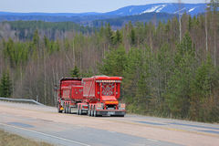 Landscape with Red Customized Gravel Truck royalty free stock photography