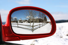Landscape reflected in the rear view mirror of a r Royalty Free Stock Photos
