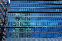 Landscape reflected in urban building Stock Photo