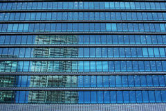 Landscape reflected in urban building Stock Image