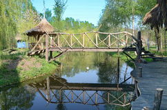 Landscape with reflected wooden bridge in lake Stock Image